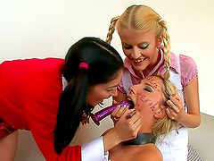 Two girls dominate a sexy teacher