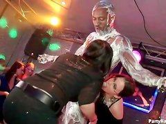 Party girls lick sweet cream off his black body