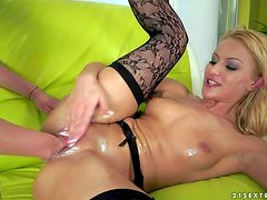 Arousing blonde bitch with natural boobs Chary Kiss in black
