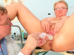 Old floosie  gets her pussy examined on gyno chair