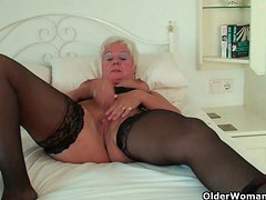 Curvy granny in black stockings rubs her old clit