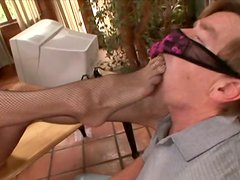 Fuckable domina in sexy stockings Darryl Hanah gives footjob to foot fetishist