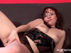 Mature hottie posing erotically and touching her cunt