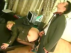 Cute blonde gets her ass fucked remarcably well on a desk