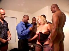 Mature mom Diva Flamingo is sucking several black dicks in a row