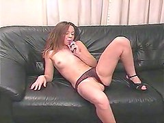 Almost titless wanker plays with a dildo for stimulating her wet pussy
