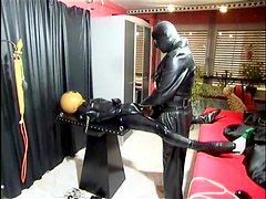 Kinky latex and leather play in dungeon