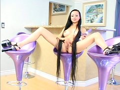 Taiwanese slutty rapunzel Ange Venus is busy with tickling her wet pussy