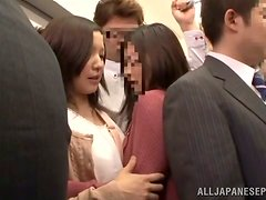 Japanese babe sucks a cock in a crowded subway train