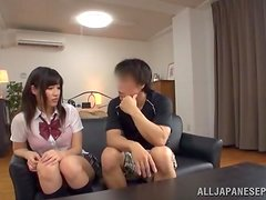 Busty Japanese teen gets pounded doggystyle on a sofa