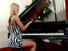 Miria the sexy blonde piano player toys her tight pussy