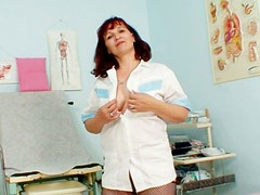 Mature and horny woman Zita stretching her pussy and showing it