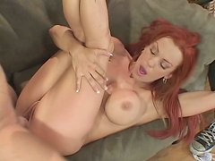 Nicely tattooed redhead Shannon Kelly mounts erected shaft