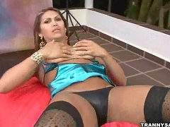 Foxy latina shemale hottie taking her clothes off