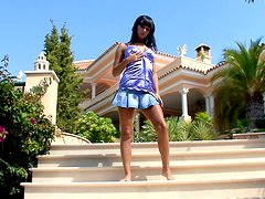 Brunette babe Carie favours herself with fingering in the yard