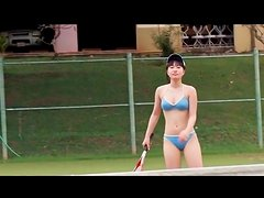 Japanese beauty plays bikini on tennis court