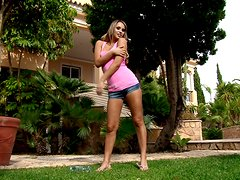 Cute blonde Alexia goes to the garden to play with her holes
