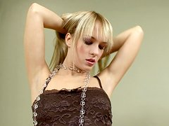 Tania the blonde hottie shows her hot pussy sitting on a chair