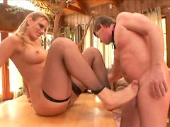 Fuckable blond slut Darryl Hanah sucks a dick and gives a footjob with her nasty-looking feet