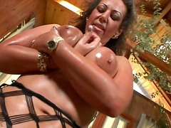 Well stacked brunette mature whore Anjelica Lauren gets her oversized tits stroked hard