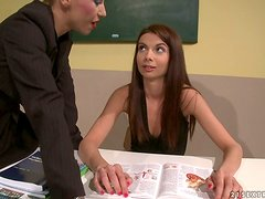 Skinny chick Betty Stylle has some lesbian fun in a classroom
