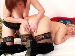 Two hussy moms in stockings please each other
