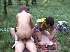 Pigtailed teens have foursome in the woods