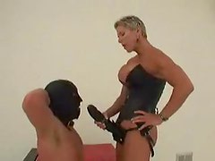 Dominant chick with huge strapon fucks slave