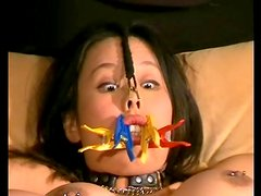 Pierced nips and pussy girl in sexy BDSM video