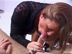 Cocksucker has her big tits out as she blows him