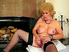 Hardcore action with a sexy granny Effie who penetrates her hairy hole with a toy