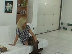 Trashy blonde whore is lap dancing on cam