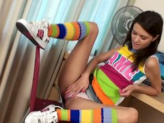 Charming and cute brunette Dasha enjoys tickling her wet pussy at home