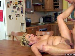 Short haired blonde granny with hanging tits and heavy make