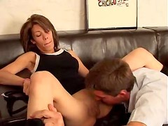Horny shaved brunette humped on couch