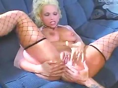 Blonde bimbo in fishnets is anal fiend