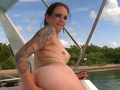 Our adorable tattooed girl Sunshine is having a boat ride across the river because the weather is