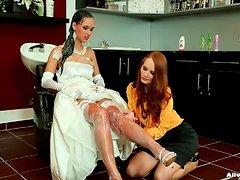 Bride in dress and gloves gets her hair washed