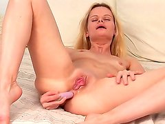 Sensual blond babe gets down to business solo