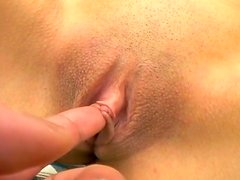 Serious looking wanker from Japan Gonzo tickles her shaved pussy tenderly