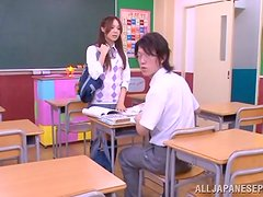 Japanese teen in swimsuit sucks a cock in a classroom