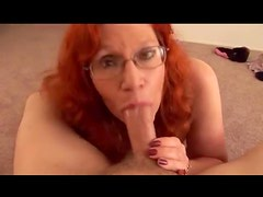 Milf redhead gives BJ and a titjob