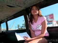 Teen cutie showing her sexy breasts in the sex bus