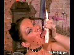 Solo girl with hot wax over her body and in her mouth