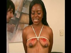 Hot wax drips down onto her tits with clothes pins