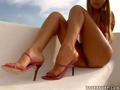 Cherry Jul gives a footjob and enjoys doggy style sex