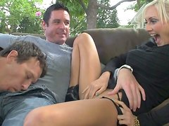 Amazing blond slut makes a horny dude to suck the dick of the other stud