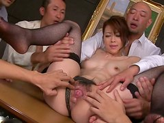 Maki Hojo is a Japanese slut thirsting for pleasing several dicks at once