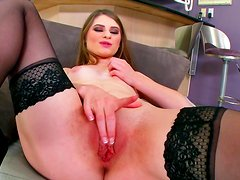 Brunette Alice March stretches her vaginal lips