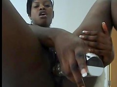 Amateur black girl showers and toys